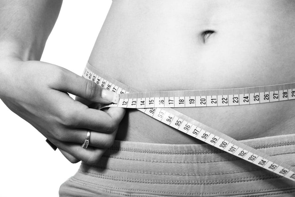 Female stomach with measuring tape
