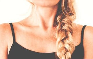 Picture of Woman's Neck with long blonde braid