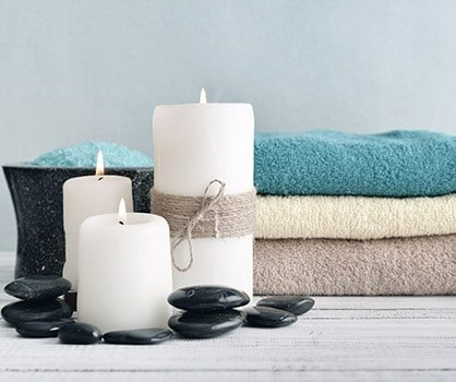 candles with lavender flowers and towels